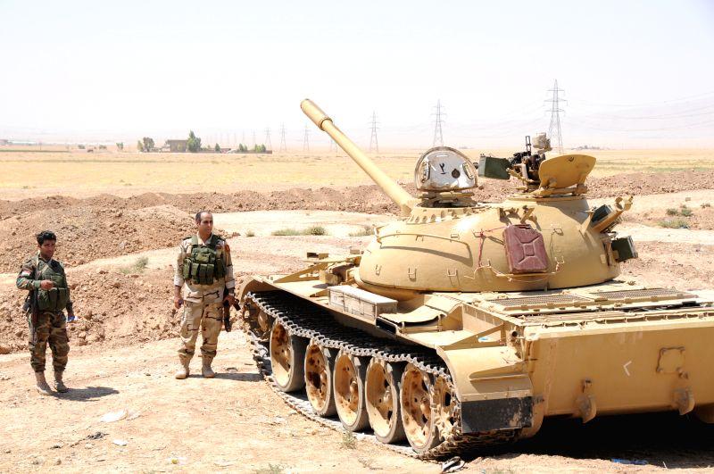 Iraqi Kurdish soldiers check weapons in Dibega district near Arbil, Iraq, Aug. 8, 2014. U.S. aircraft bombed Islamic State artillery attacking Kurdish forces near ...