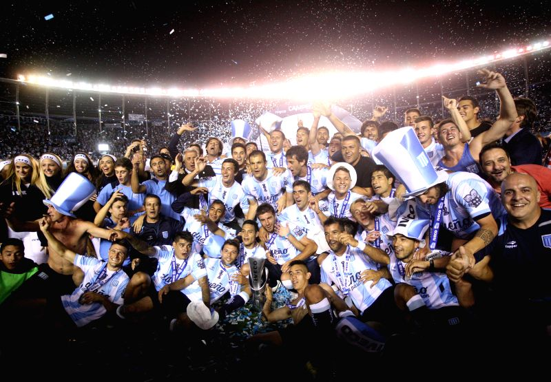 Argentina : Players of Racing Club celebrate with the trophy at the end of the Final match against Godoy Cruz of Argentinean Soccer First Division at Presidente Peron Stadium, in Avellaneda City, ...