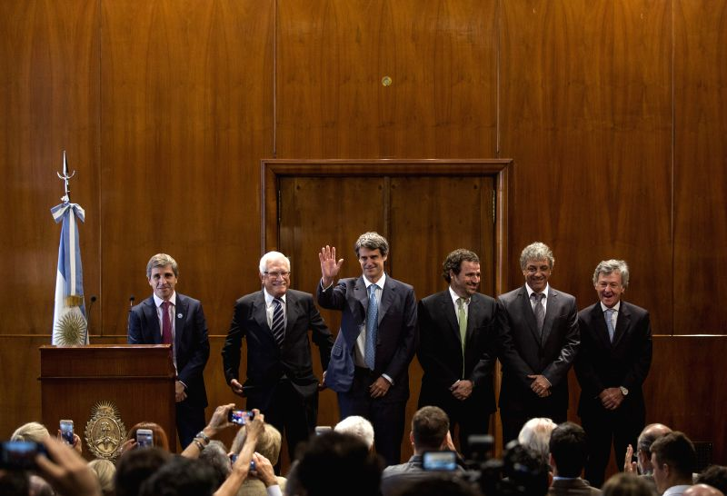 Argentina's Finance Minister Alfonso Prat Gay (3rd L) presents his economic team in Buenos Aires, Argentina, on Dec. 11, 2015. - Alfonso Prat Gay