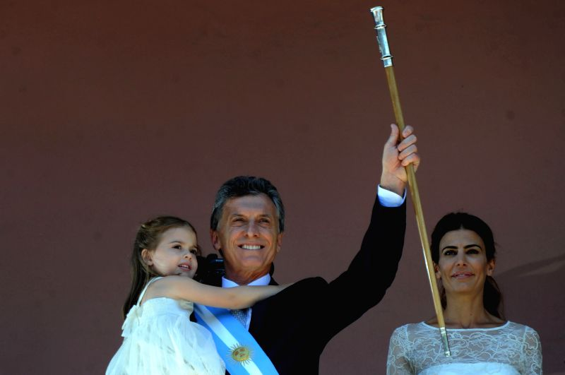 Argentina's new President Mauricio Macri (C), his daughter Antonia (L) and wife Juliana Awada are seen at the balcony of Casa Rosada (Pink House) in Buenos ...