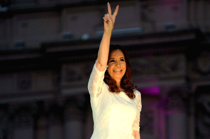 Argentina's President Cristina Fernandez interacts with her supporters during the farewell ceremony at May Square, in Buenos Aires, Argentina, on Dec. 9, 2015. ...