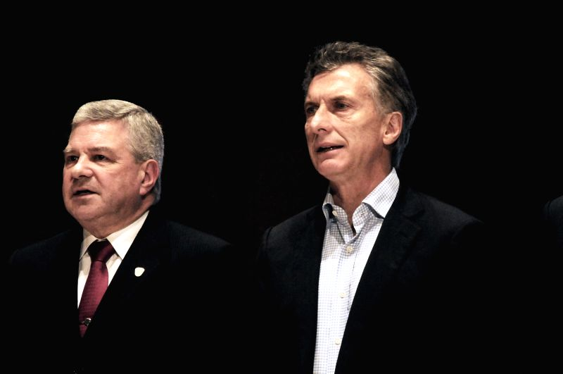 Argentina's presidential candidate Mauricio Macri of the conservative Cambiemos (R) hosts the celebration of the 7th anniversary of the Metropolitan Police, at ...