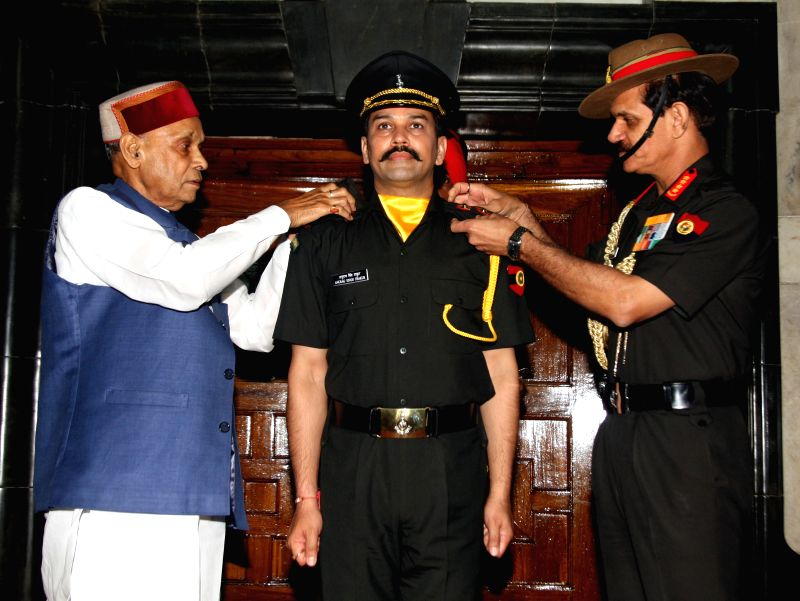 Army chief Dalbir Singh Sihag commissioning BJP MP Anurag Thakur into the Territorial Army in Delhi on Friday. The BJP leader\'s father Prem Kumar Dhumal is also seen in the picture. - Dalbir Singh Sihag and Prem Kumar Dhumal
