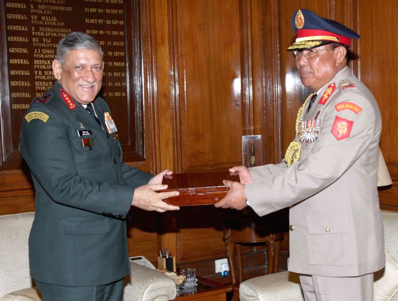 Army chief General Bipin Rawat presents a memento to the Bhutanese Army Chief Lt. Gen. Batoo Tshering, in New Delhi on Dec 6, 2018.