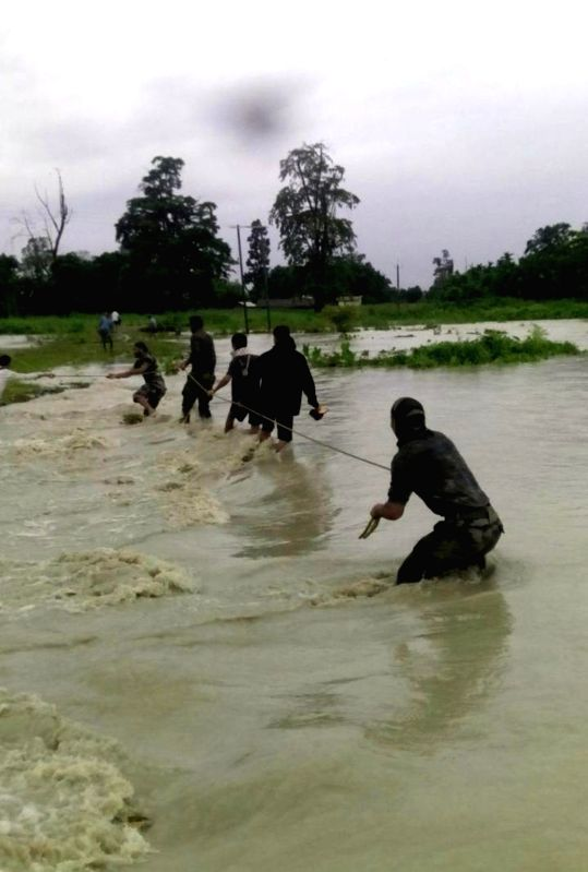 Army conducts rescue operation in the flooded areas of Chirang district in Assam on July 22, 2016.