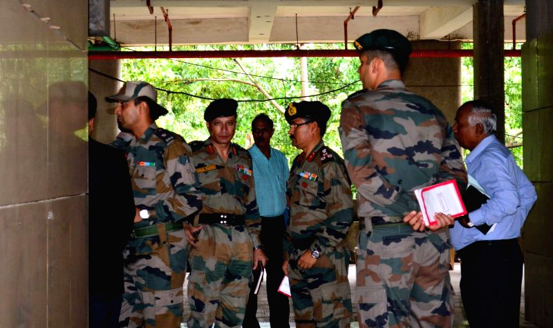 Army personnel arrive at Adarsh Cooperative Housing Society building to take charge of the building following Supreme Court instructions in Mumbai on July 29, 2016.  The Supreme Court last ...