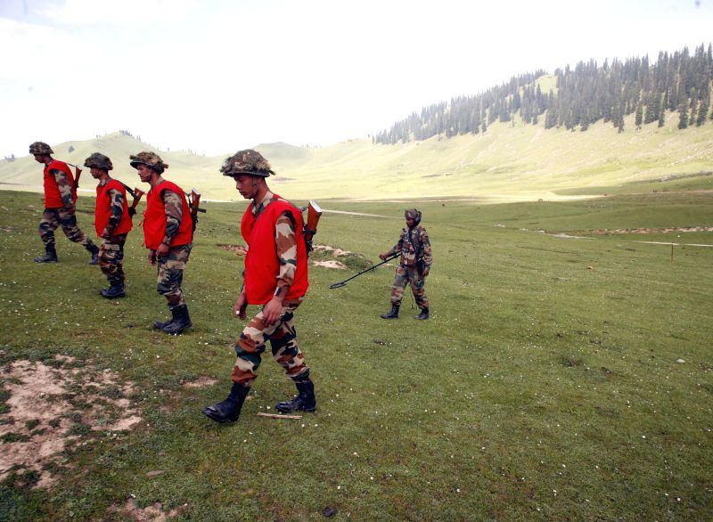 Army personnel carry on `Mission Falah` on Tosa Maidan - a huge meadow in the foothills of Pir Panjal range in Jammu and Kashmir's Budgham district on Aug 5, 2014.
