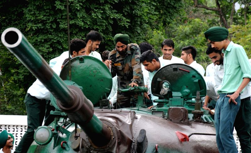 Army personnel display weapons to students during 'Know your Army' exhibition in Amritsar on Aug 10, 2016.