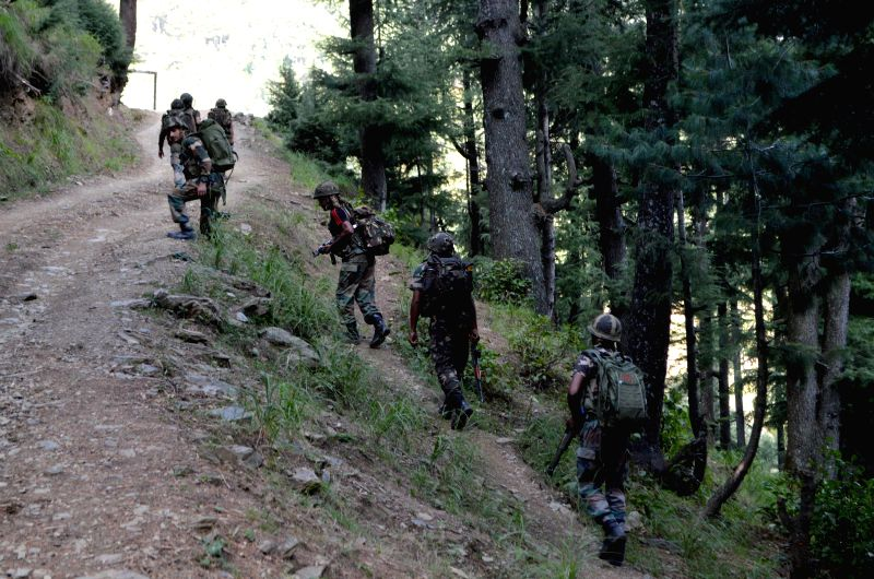 Army personnel during an encounter with militants in Lolaab Forests of Jammu and Kashmir's Kupwara district on Aug 26, 2014.