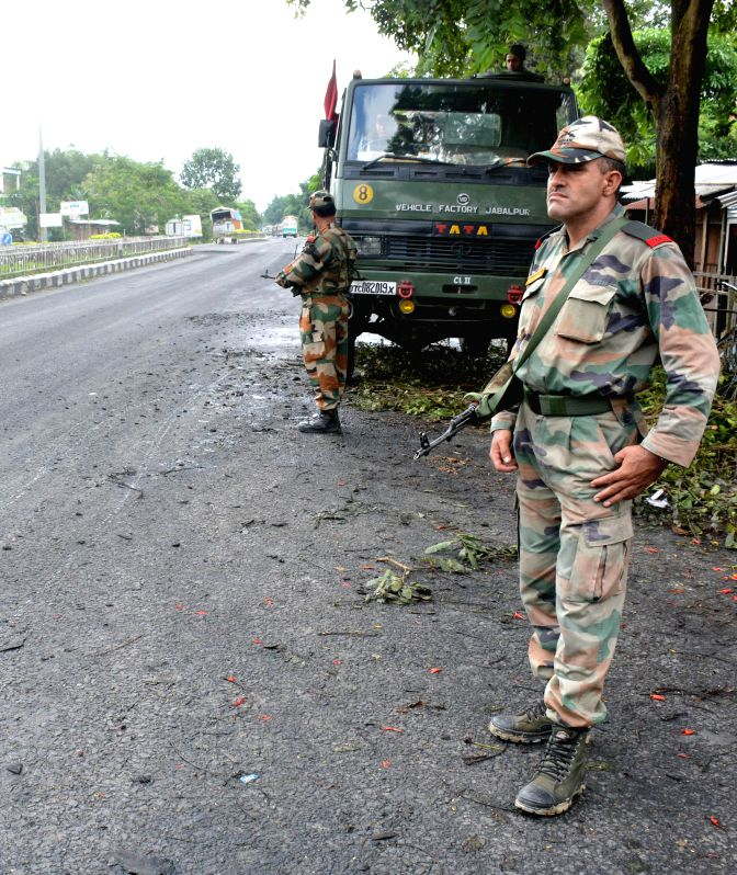 Army personnels carry on flag march at National Highway 39 in the tension-gripped Golaghat in Assam on Aug 23, 2014.