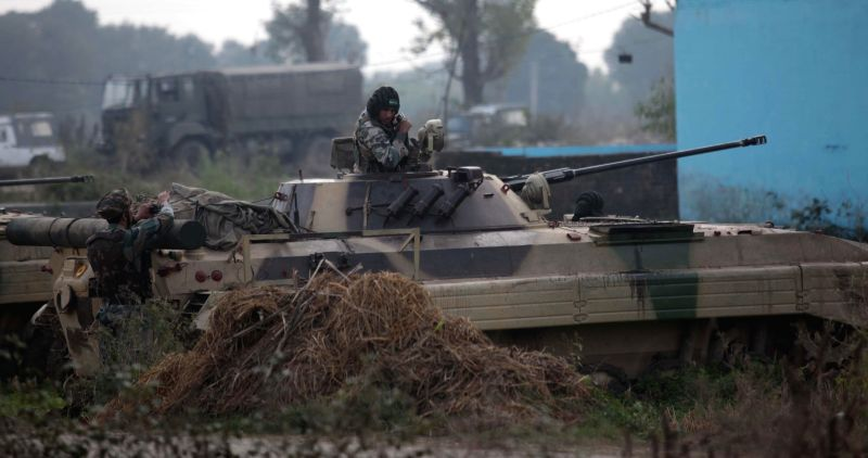 Soldiers take positions during a gunbattle with heavily armed militants who sneaked into the Indian side of the border from Pakistan Thursday (27th November), at Arnia in Jammu district of ...