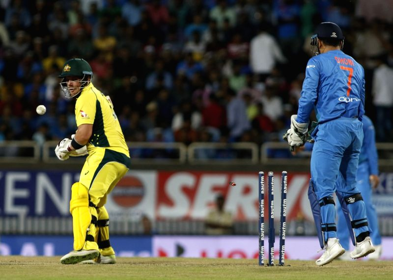 Aron Finch of Australia gets dismissed during the first T20 match between India and Australia at JSCA International Stadium in Ranchi on Oct 7, 2017.