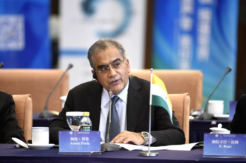 Aroon Purie, Chairman and Editor-in-Chief of India Today Group, speaks during the first BRICS Media Summit in Beijing, capital of China, Dec. 1, 2015. (Xinhua/Chen ...