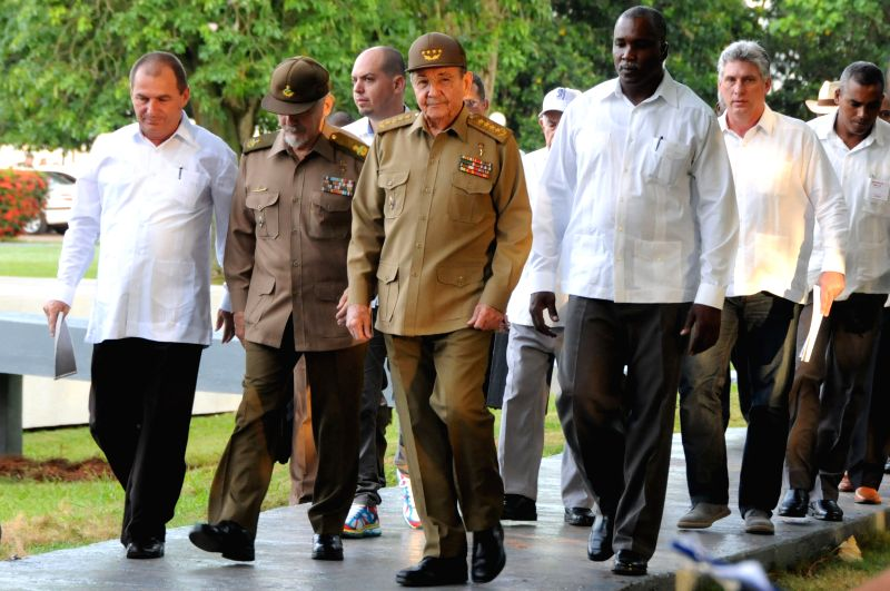 The President of Cuba, Raul Castro(C), accompanied by the first Cuban Vice President, Miguel Diaz Canel (2nd R) arrive for the commemoration ceremony of the ...