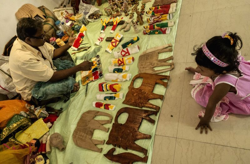 Artisans from different districts of West Bengal attend a workshop on traditional doll in Kolkata, on Aug 2, 2016.