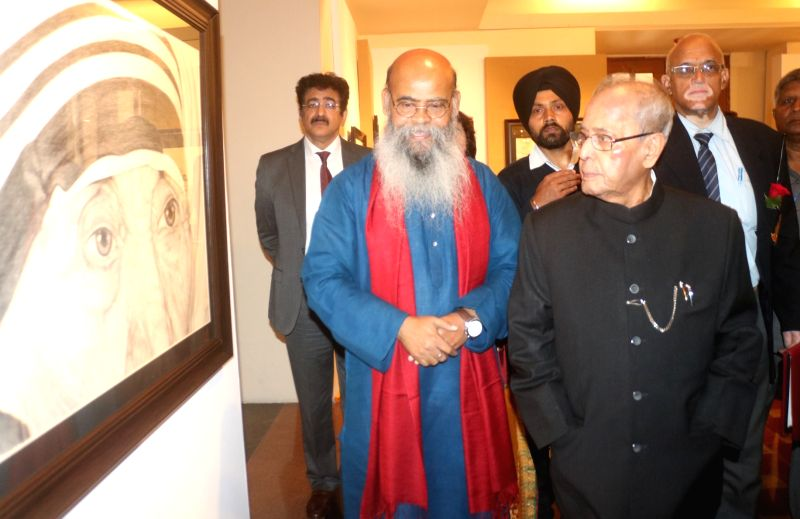 Artist Dipak Kumar Ghosh with Former President Pranab Mukherjee at the portrait of Mother Teresa during a portrait exhibition in New Delhi on Feb 3. 2018. - Dipak Kumar Ghosh and Pranab Mukherjee