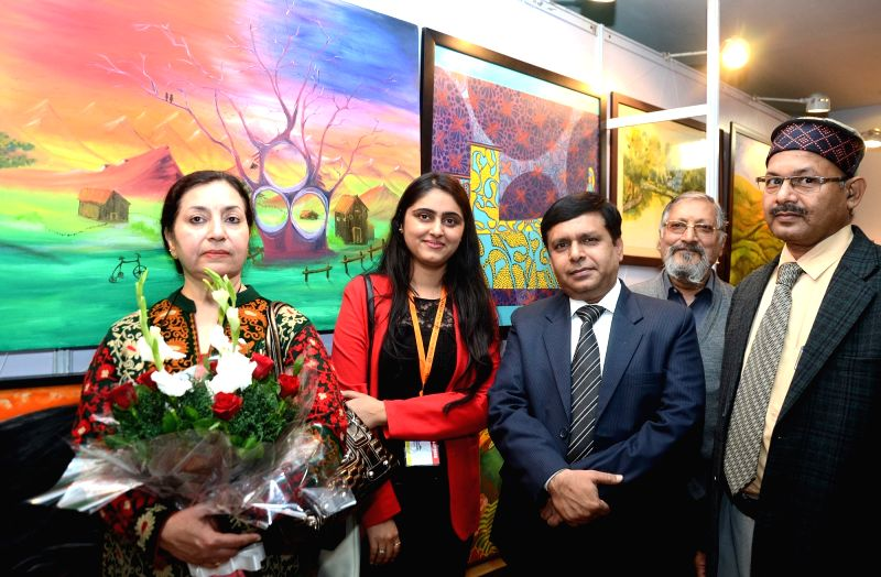 Artist Kirti Chawla with her paintings at the 4th Delhi International Film Festival in NDMC Convention Centre in New Delhi, on Dec 6, 2015.