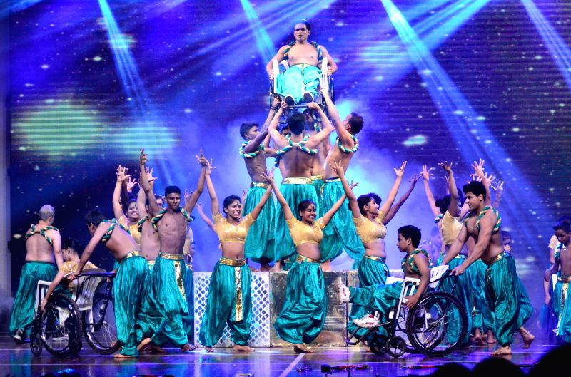 Artist performs during the Mumbai finale of Shiamak Davar`s show Winter Funk in Mumbai on Nov 28, 2014.