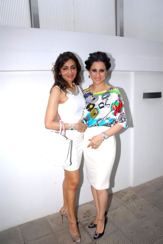 Artist Rouble Nagi with Socialite Queenie Singh during her birthday celebration in Mumbai on July 7, 2014. - Queenie Singh