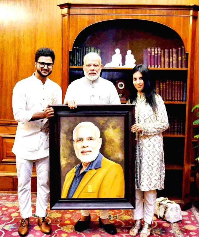Artist Suvigya Sharma presented his painting to PM Narendra Modi - Suvigya Sharma and Narendra Modi