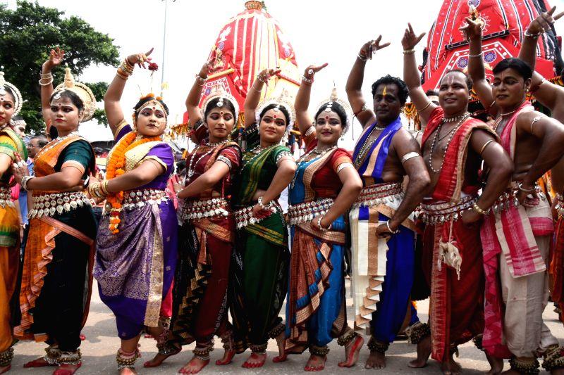 Artistes perform during Jagannath Rath Yatra, in Odisha's Puri on July 14, 2018. The nine-day festival includes Gundicha Yatra, Bahuda Yatra, Sunavesha, Nabajoubana Darshana and Niladribije.