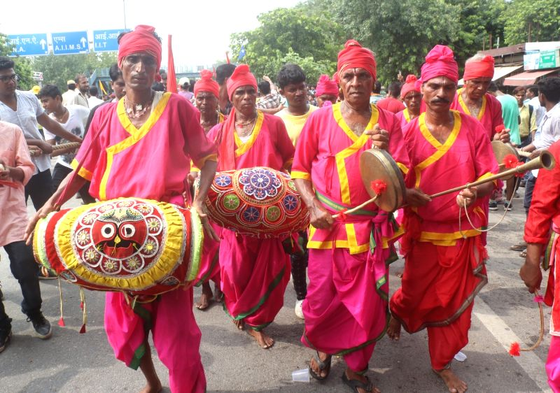 Artistes perform during Jagannath Rath Yatra, in New Delhi on July 14, 2018. The Rath Yatra is an annual celebration, marking the annual journey of Lord Jagannath and his two siblings...