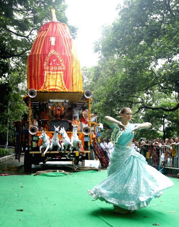 Artistes perform during 'Ulta Rath Yatra'- the return of the chariots of Lord Jagannath and his two siblingsLord Balaram and Goddess Subhadra, in Kolkata on July 22, 2018.