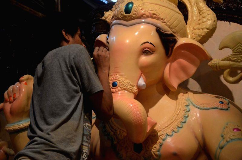 Artists busy making Ganesh idols at a Mumbai workshop in Mumbai on Aug 8,2016.