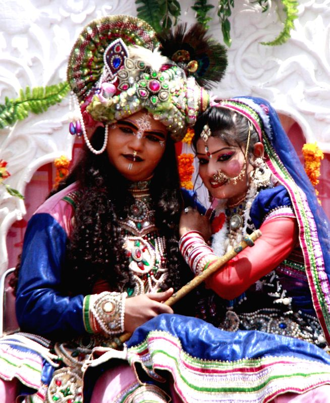 Artists disguised as lord Krishna and Radha during a Janmashtami programme in Gurgaon on Aug 17, 2014.