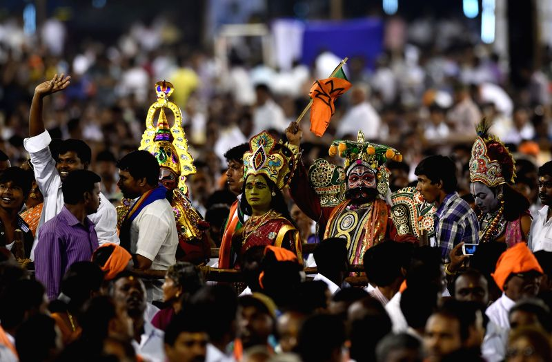 Artists disguised as mythological characters during a BJP programme in Chennai, on Dec 20, 2014.