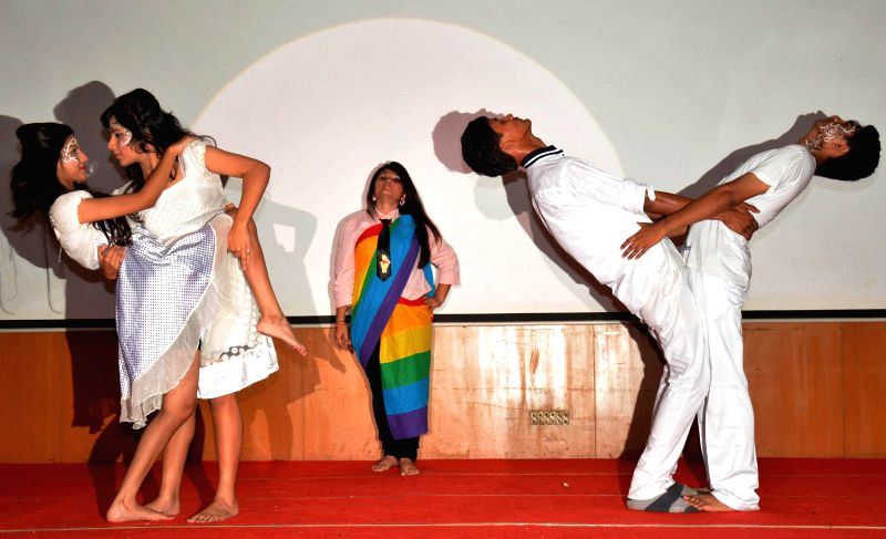 Artists enact a play at the inauguration of Lesbian Gay Bisexual Transgender (LGBT) Film and Video Festival organised by XUKIA in Guwahati on Aug 8, 2014.
