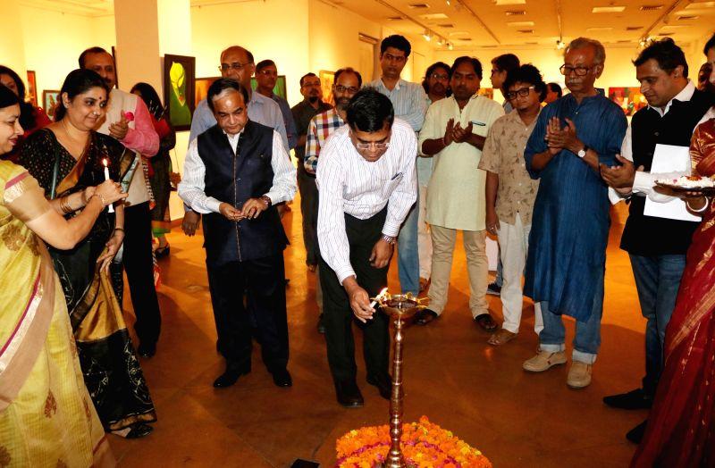"""Artists Niren Sen Gupta, Prince Chand, Gagan Vij, Yash Jaswal, Vimal Chand, Madhu Priya, Poonam Kohli, Kuldeep Kumar and Radhey Shyam at the launch of """"Eternal Peace"""" an art ... - Niren Sen Gupta, Poonam Kohli, Kuldeep Kumar and Radhey Shyam"""