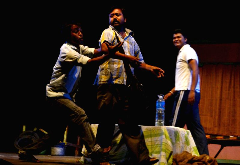 Artists of Puhar group stage 'Sangupane' - a drama during a drama competition at Rabindra Bhawan in Guwahati on May 12, 2014.