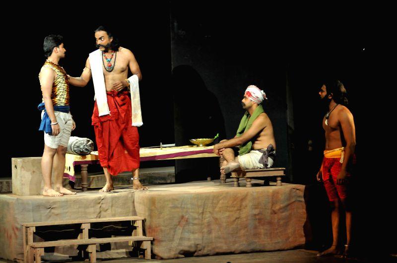 Artists of Ranga Payana performing drama of ``Vandanondu Kaladalli`` at Ravindra Kalakshetra, in Bangalore on April 19, 2014.