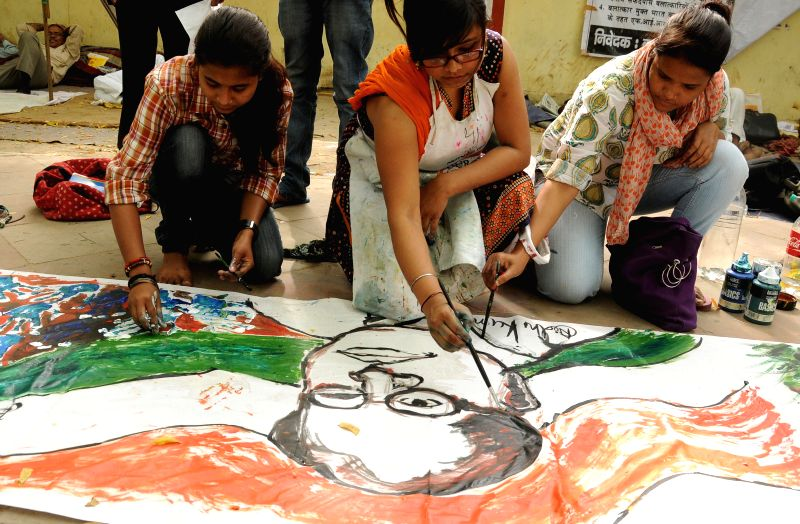Artists paint a picture of B. R. Ambedkar on the eve of his birth anniversary at Jantar Mantar in New Delhi on April 13, 2014.