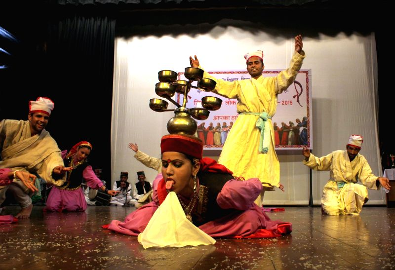 Artists participate in a Folk Dance competition in Shimla, on June 22, 2015.