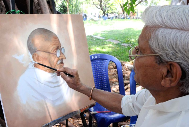 Artists participate in a painting competition during inauguration of 'Samskruti Habba' (Cultural Festival) at Ravindra Kalakshetra in Bangalore on April 20, 2014.