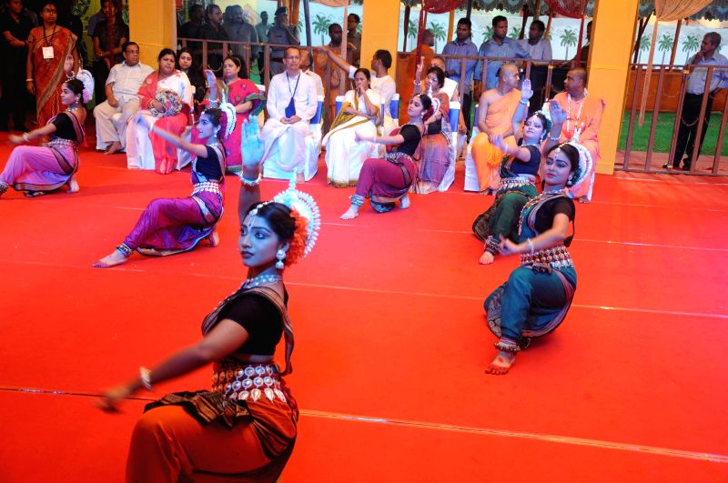 Artists perform a traditional dance in presence of West Bengal Chief Minister Mamata Banerjee at ISKCON (International Society for Krishna Consciousness) temple in Kolkata on June 29, 2014.