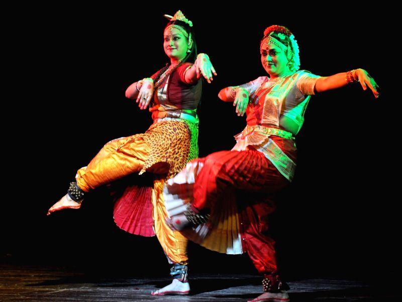 Artists perform Bharatanatyam during `Nrittya-Utsav` organised by Prayas Kala Kendra at District Library Auditorium in Guwahati on Sept 3, 2014.