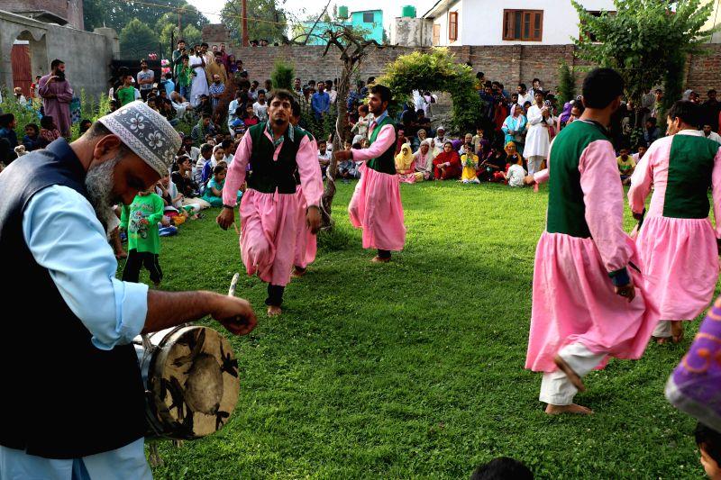 Artists perform `Dambali` or  Dervish dance at the Lal Bab Sahib shrine in Srinagar on Aug 7, 2015.