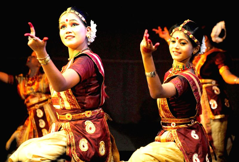 Artists perform during a cultural evening at Rabindra Bhawan in Guwahati on July 26, 2014.