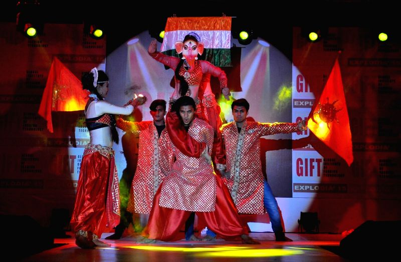 Artists perform during a fashion show in Kolkata, on Dec 11, 2015.