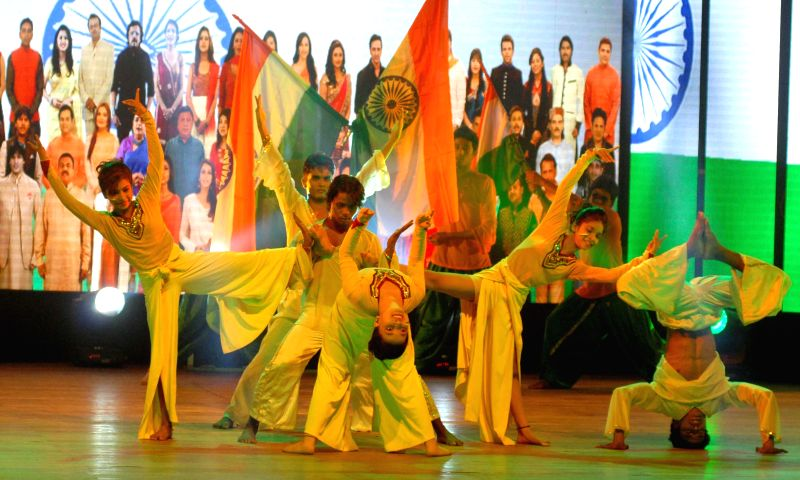 Artists perform during a programme in Kolkata on Aug 19, 2014.