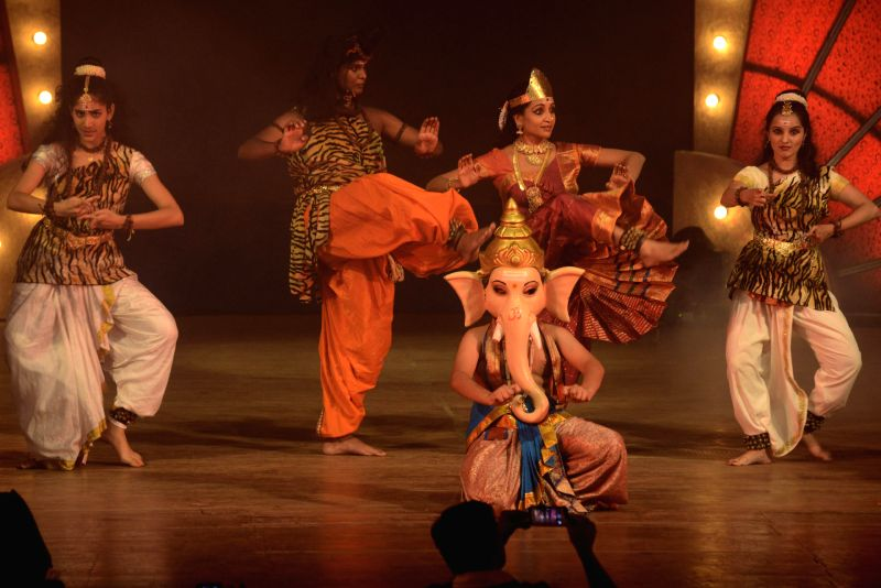 Artists perform during Ameri Kannadothsava 2014 at Ravindra Kalakshetra in Bangalore on July 12, 2014.