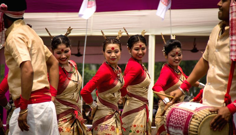 Artists perform during Mukoli Bihu a programme organised by AASU at Judges' Field in Guwahati on April 15, 2014.