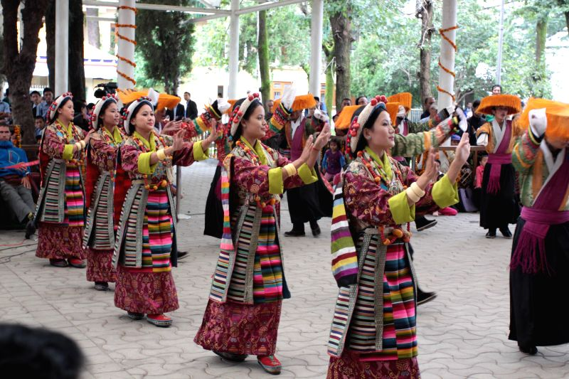 Artists perform during the 54th anniversary of Tibetan Democracy Day at Tsug la Khang temple in McLeod Ganj of Dharamshala on Sept 2, 2014.