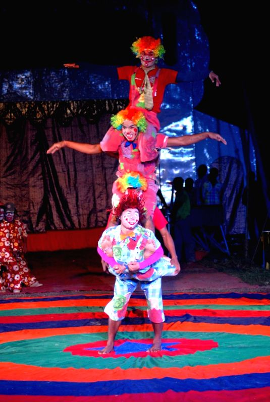 Artists perform during the opening show of Ajanta circus in Kolkata, on Dec 8, 2015.