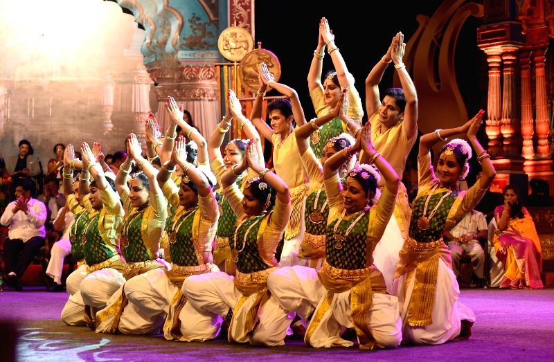 Artists perform during the State (Karnataka) Film Awards ceremony at Maharaja College Grounds, in Mysuru on 28 Feb , 2015. Also seen actor Darshan and actress Nivedita. - Darshan