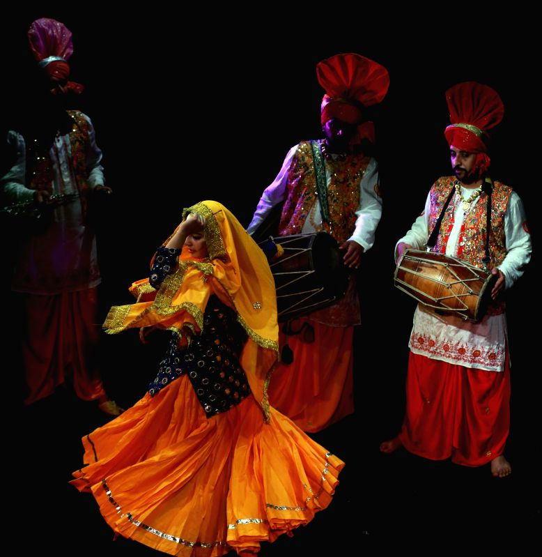 Artists perform Indian traditional dance and music of the north Indian state Punjab at the International Theater in Frankfurt, Germany, on Nov. 1, 2015. ...