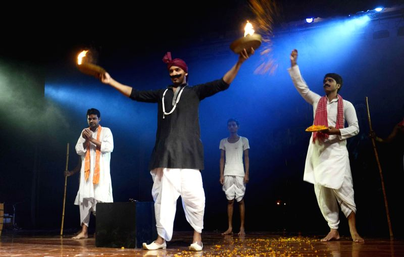 Artists stage a play based on Munshi Premchand's story Sadgati in Patna on August 1, 2014.